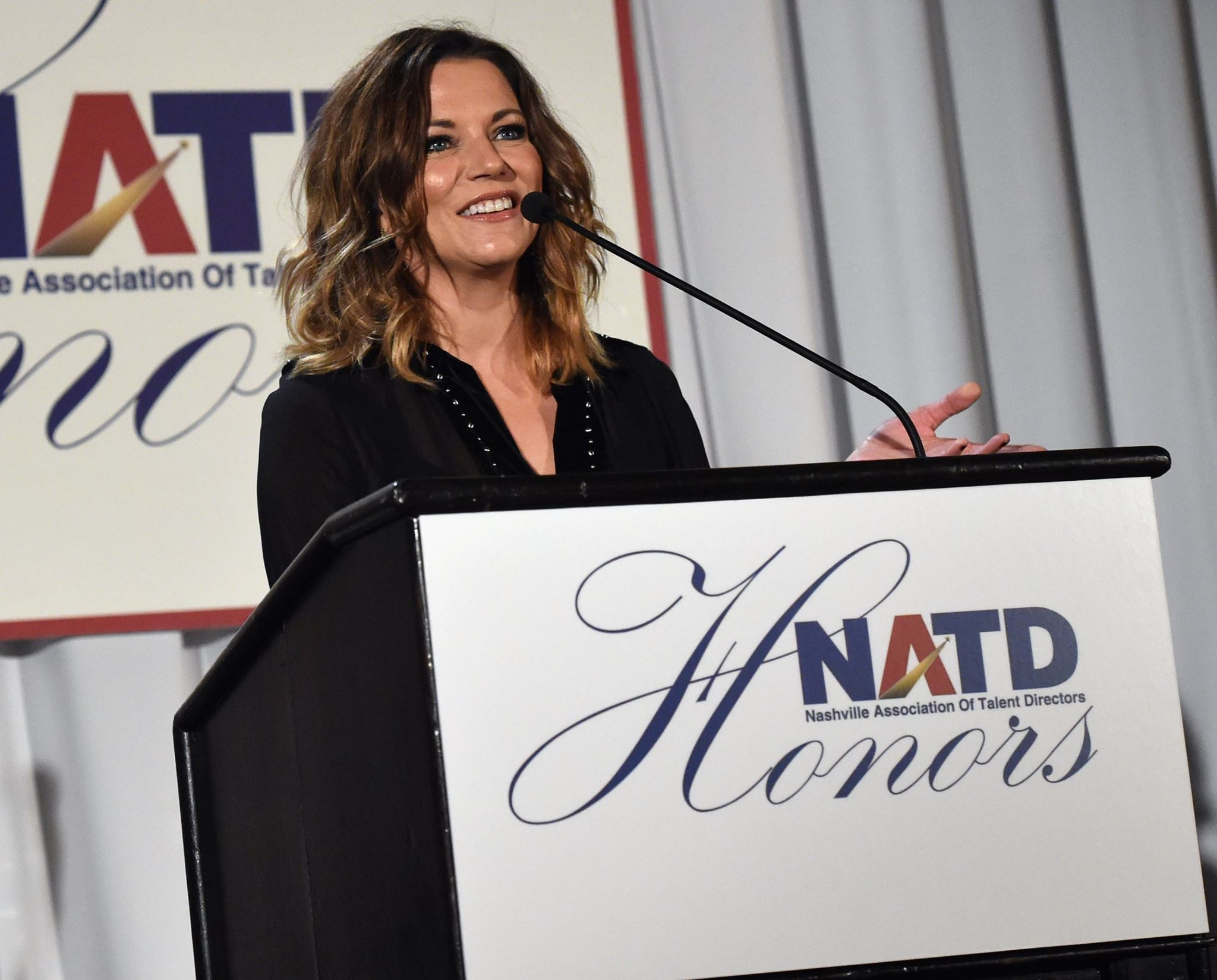 Martina McBride presenting to Honoree Rod Essig