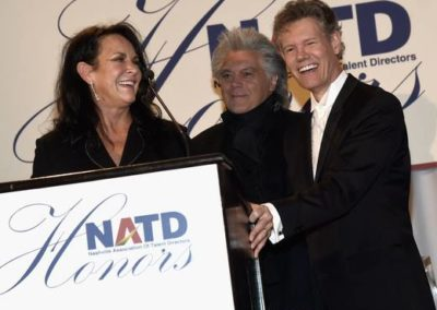 Mary Davis and husband, Honoree Randy Travis, with Marty Stuart