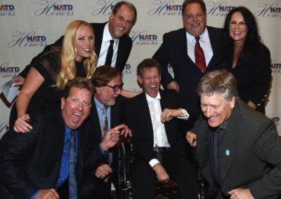 (Back row) Stephanie Langston, Jeff Davis, Tony Conway, Mary Davis, (front row) Shawn Parr, Honoree Rod Essig, Honoree Randy Travis & John Huie